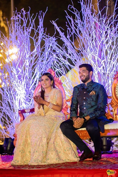 Candid picture of the couple at the sangeet