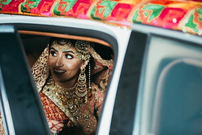 The bride sitting in the car, ready to leave for her marital home