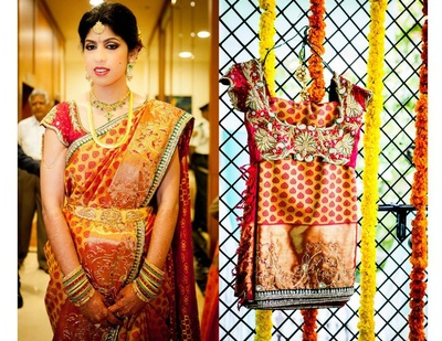 Gold kanjivaram silk saree with red woven buttis, styled with a red embellished blouse and traditional gold jewellery