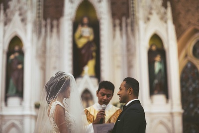 The couple taking their vows in a church