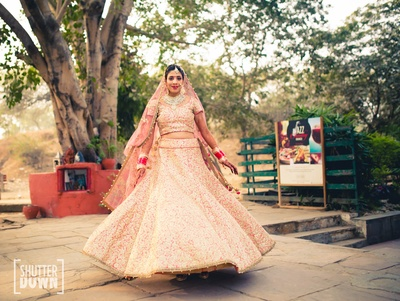 The bride twirling in her pink lehenga