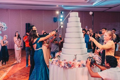 Bride and groom cut their wedding cake during the reception