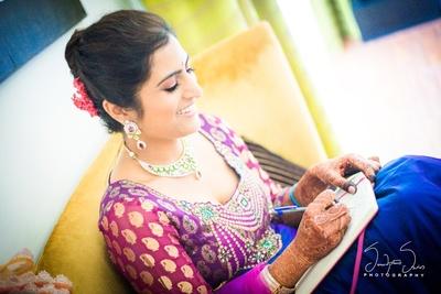Beautiful bride wearing fresh purple brocade kurti styled with diamond jewellery.