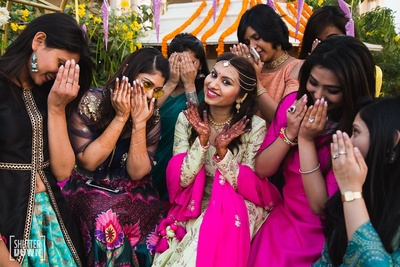 Hand mehndi designs showcased by the bride and her bridesmaids