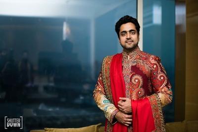 The groom posing in his wedding sherwani before the functions start