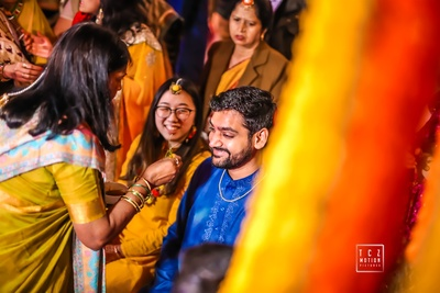 a candid capture of the couple during the haldi ceremony