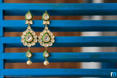 Polki and kundan studded earrings with pearl drops