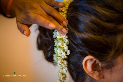 Twisted messy bun styled with mogra floral strings