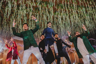 groom dancing with his groomsmen for the sangeet ceremony