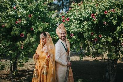 The bride rocks a mango-hued lehenga, while the groom looked dapper in a beige achkan.