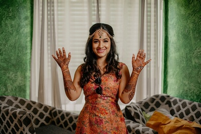 The pretty bride showing off her mehendi