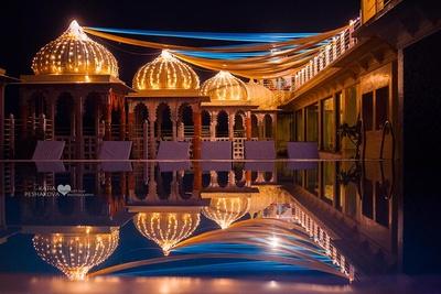 Fairy lights and colorful drape decor for the mehendi ceremony held at Chunda palace, Udaipur.