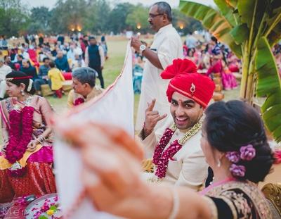 The happy groom at his wedding mandap