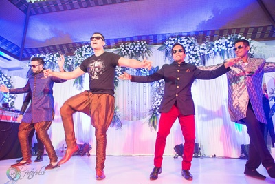Performing in copper jodhpuri pants and a T-shirt for the sangeet ceremony
