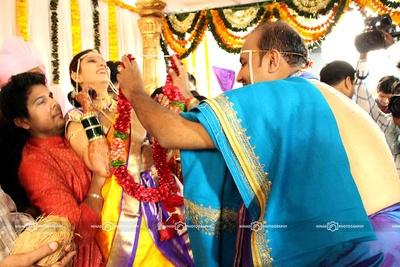 Groom dressed in sky blue Angavastram and purple silk dhoti