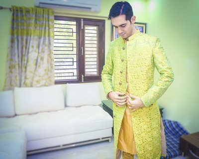 Gold and green achkan for the wedding ceremony held at The Heritage Grand, Delhi