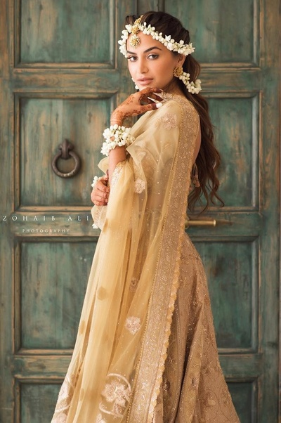 bridal portrait shot in her glam haldi golden lehenga