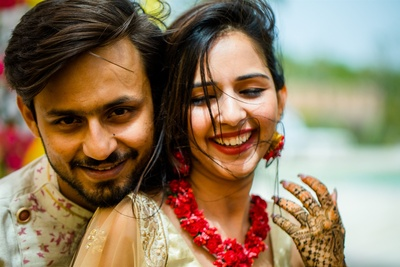 a cute picture of the couple at their mehendi ceremony