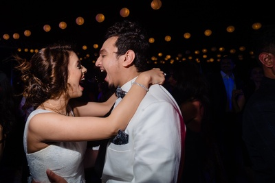 the bride and groom dancing at their engagement