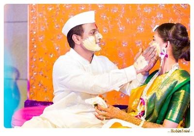 White dhoti-kurta styled with a matching gandhi topi
