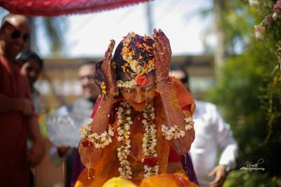 Bride drenched in Haldi!