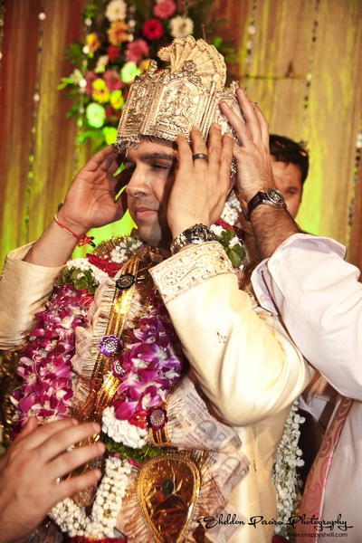 Groom garnished with a garland made with Orchids and Jasmines