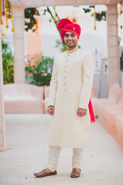 The groom posing on his wedding day