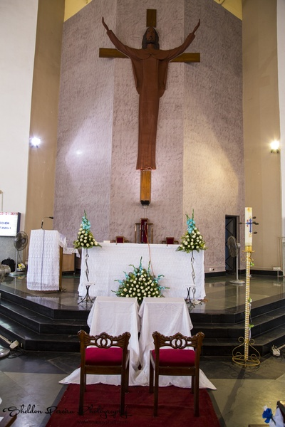 Church altar decorated with floral bouquets for the nuptials
