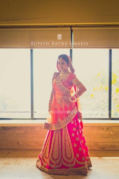 Rani pink and orange designer bridal lehenga