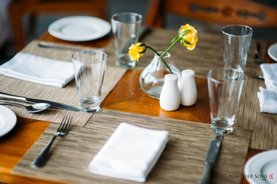 Delicate centerpieces with yellow Roses in crystal flower vases
