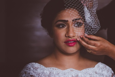 Bride Ujwala getting ready in her beautiful white wedding gown.