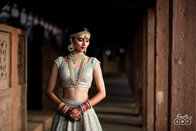 Bride poses for Knots by AMP before the wedding