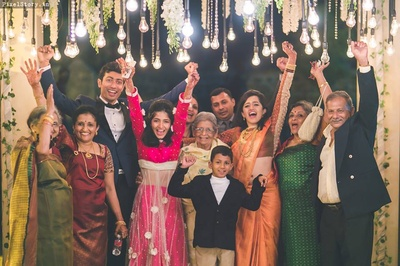 Perfect family picture with right amount of flower and light decor around.