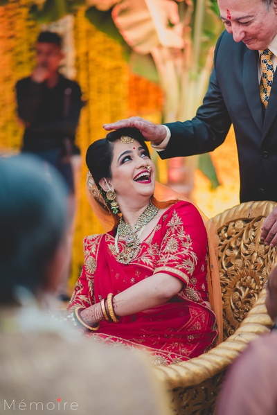 The bride captured in a candid shot with her uncle