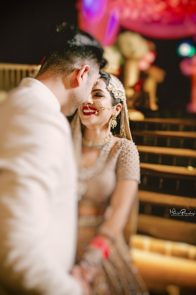 Cute couple caught in a candid wedding photography