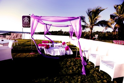 Unusual wedding seating - Pink and white cabanas set up by the beach