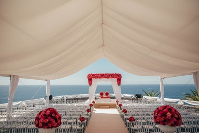Gorgeous white and red wedding venue decor