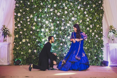 A candid picture of the bride and groom dancing at their sangeet ceremony