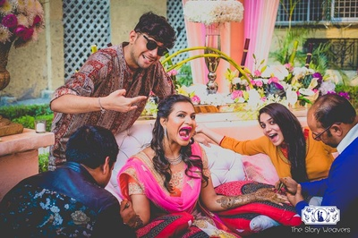 crazy faces always make for great pictures at a mehndi ceremony