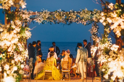 The wedding ceremonies taking place against a picturesque setting, by the beach!
