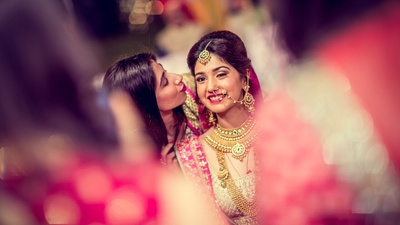 Candid shot of the bride and her bridesmaid before the wedding function at Radisson Blu Udaipur