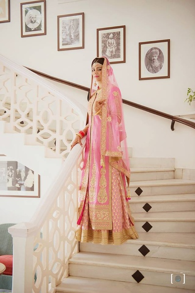 Wearing pastel pink anarkali with gold embroidery styled with kundan jewellery.
