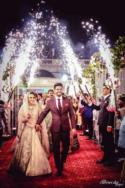 The newly married couple walking towards their reception
