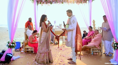bride and groom taking their wedding vows in the mandap