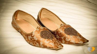 Custom made mojris embellished with stone details fro the groom