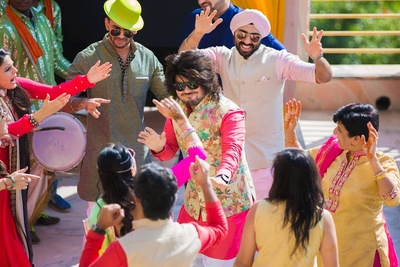 Groom and guests dancing on the beats of Dhol for the mehendi ceremony.