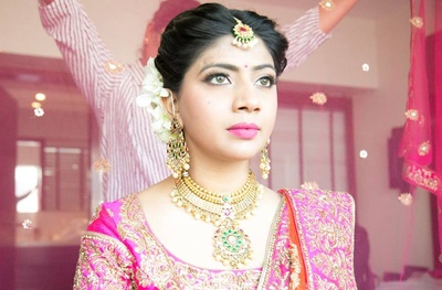 Pink wedding lehenga styled with kundan and gemstones studded necklace set