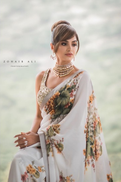 bridal portrait shot in glam mehendi sabyasaachi saree