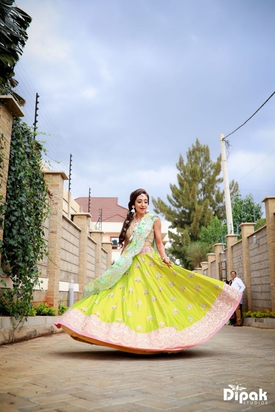 Captured in a beautiful shot, the Bride in a Neon green Lehenga