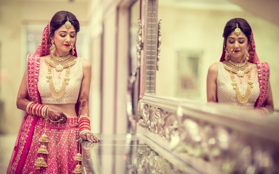 Bridal shots of the traditional bride in her pink Anita Dongre lehenga